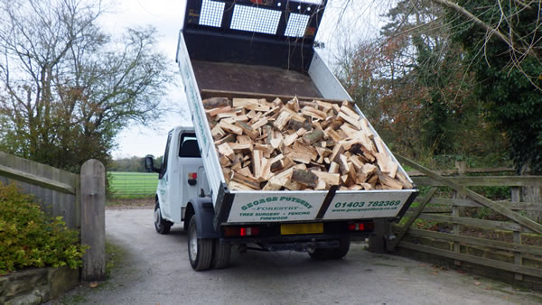 Photo of Traditionally Seasoned firewood on a Transit.